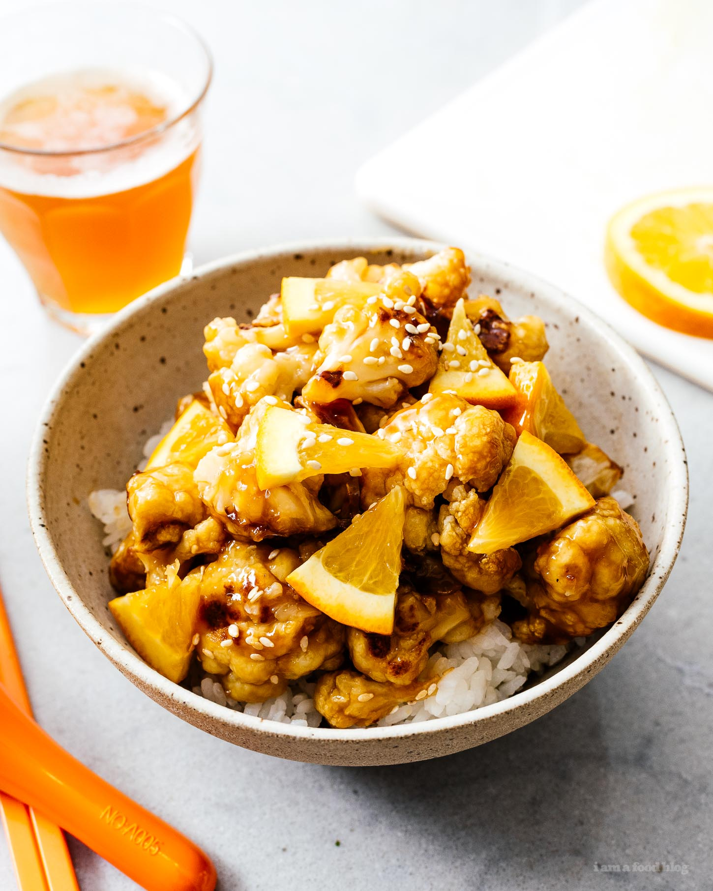 A super healthy, delicious, and easy oven broiled vegan orange cauliflower recipe. Everything that's great about orange chicken with zero guilt. #vegan #orangechicken #easyrecipes