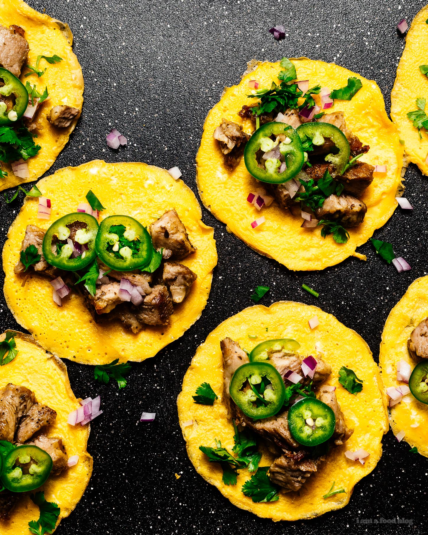 """Keto Instant Pot carnitas inspired street tacos: Keto friendly low carb street style carnitas inspired tacos with egg """"tortillas."""" They look just like the real thing and the taste amazing! Crispy pork flavored with oregano and cumin made quick and easy in the Instant Pot. #keto #ketorecipes #instantpot #eggs #macros #porkrecipes #ketoporkrecipes #lowcarb #recipes"""