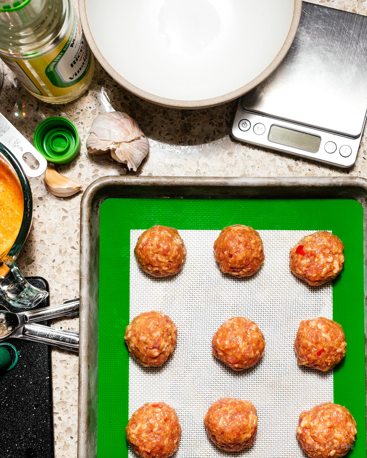 These low carb, keto friendly piri piri pork meatballs bring the spice and flavor. They're baked in the oven for maximum ease and are served with cooling Greek yogurt for a tangy, creamy contrast. No more breadcrumbs! #piripiri #meatballs #recipes #dinner #bakedmeatballs #lowcarb #keto #ketorecipes #ketofriendly