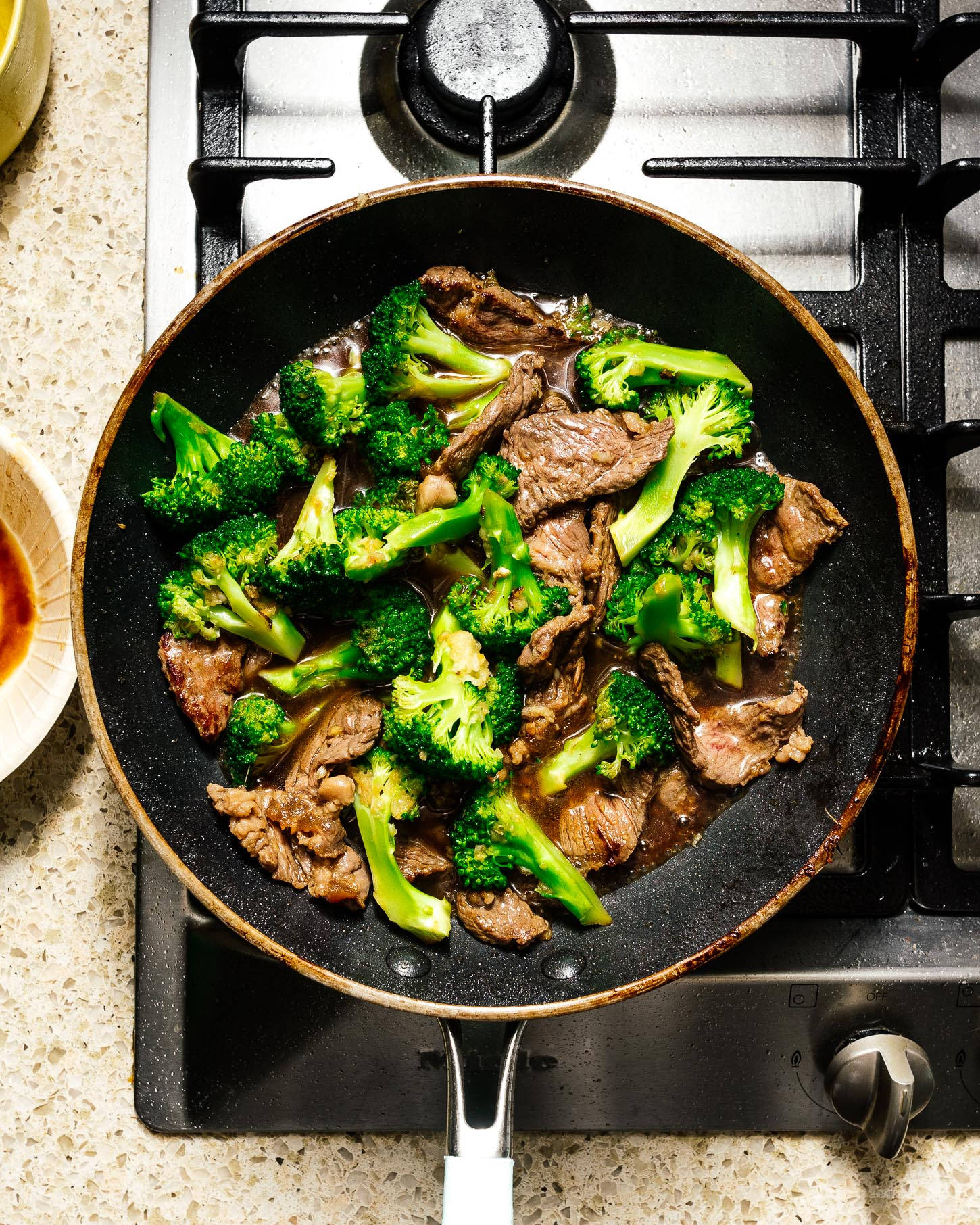 This easy keto friendly low-carb beef and broccoli stir fry is for all my peeps who are trying to enjoy life while still cutting down on carbs. Savory juicy beef and tender green broccoli in an addictive sauce. Super tasty and quick. Meal prep it for the week (double the batch) and you're golden! #keto #ketofriendly #protein #macros #stirfry #cauliflowerrice #beefandbroccoli