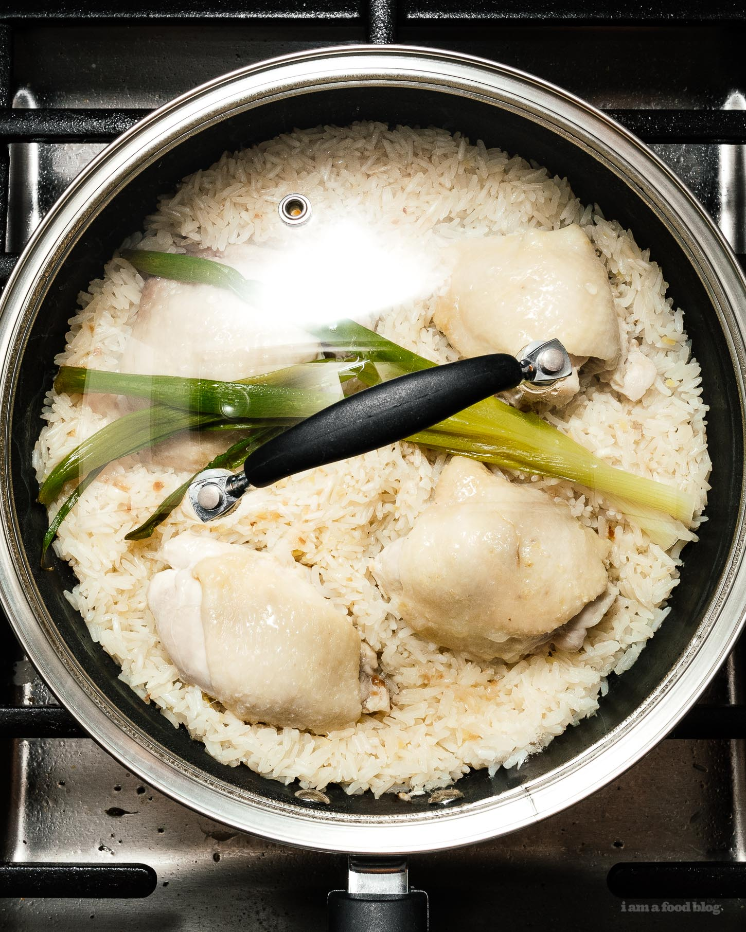 Super simple and satisfying Hainanese chicken rice: juicy steamed chicken and ginger garlic rice cooked in the same pot. It's what you want for dinner, right now! #hainanesechickenrice #chickenrice #recipes #dinner #onepot #easy #chickenrecipe #rice #chickenandrice