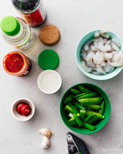 Shrimp and snap pea stir fry: a glossy, spicy, all-in-one protein and veggie dish that is just the perfect thing to make for a quick weeknight dinner. #stirfry #dinner #shrimp #snappeas