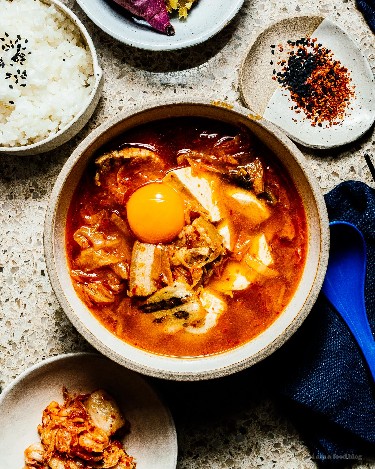 Warm and comforting sundubu jjigae/spicy kimchi soft tofu stew #kimch #tofu #korean #recipes #dinner #soup #stew #tofustew #tofusoub