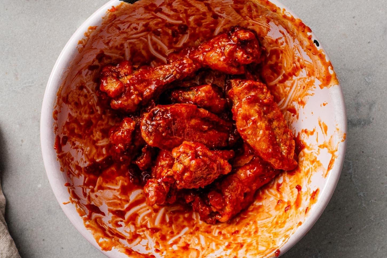 tossing korean fried chicken | www.iamafoodblog.com