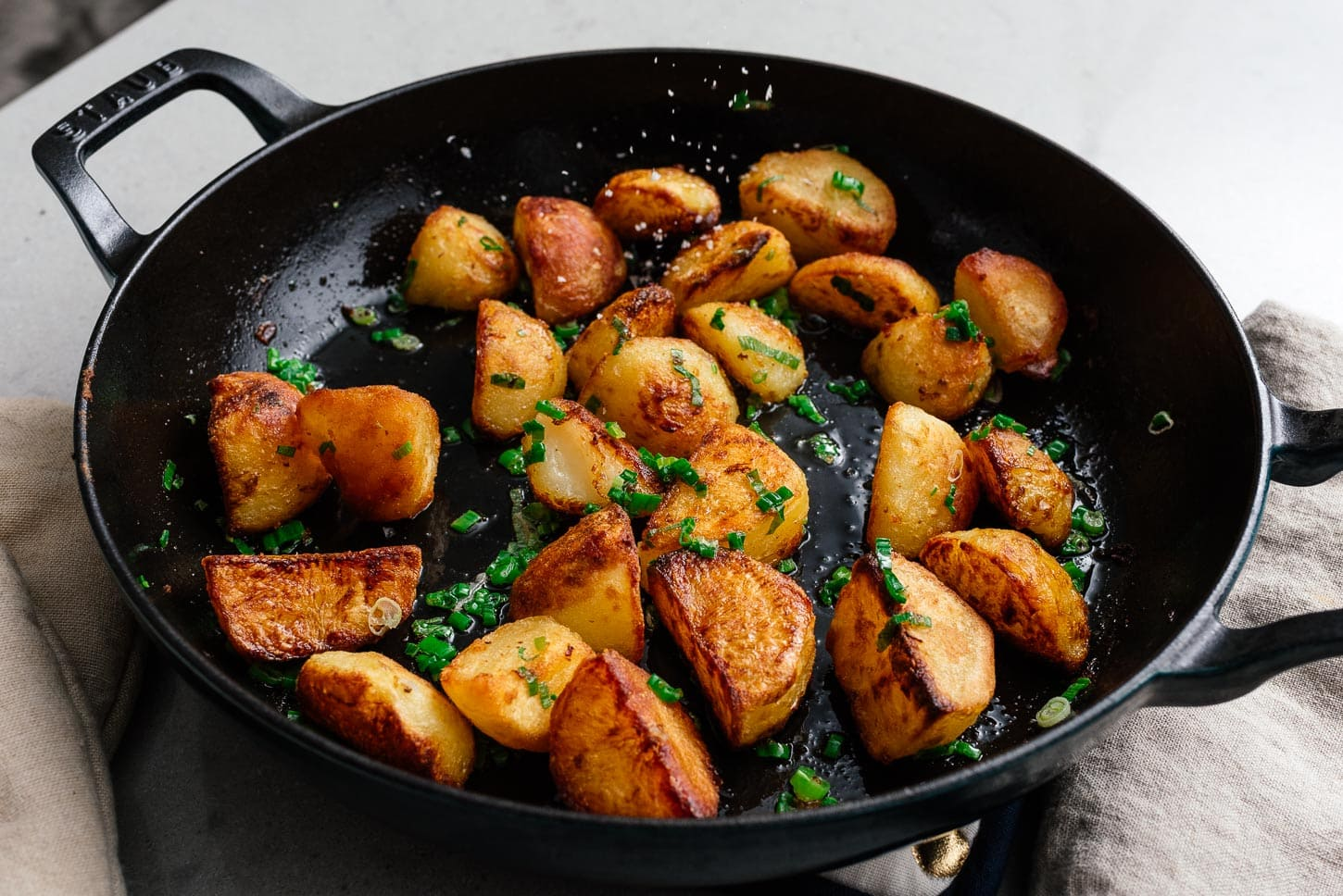 seasoning roasted potatoes with sea salt | www.iamafoodblog.com