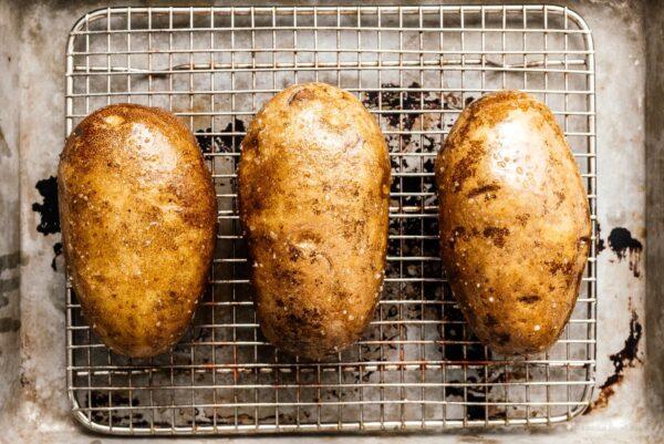 potatoes on baking rack ready to bake | www.iamafoodblog.com