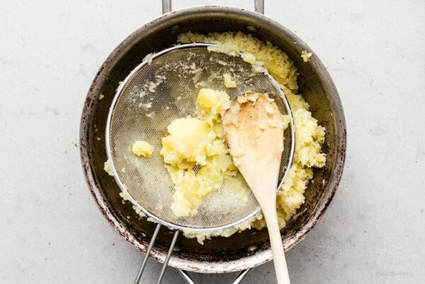 mashing potatoes with a sieve   www.iamafoodblog.com