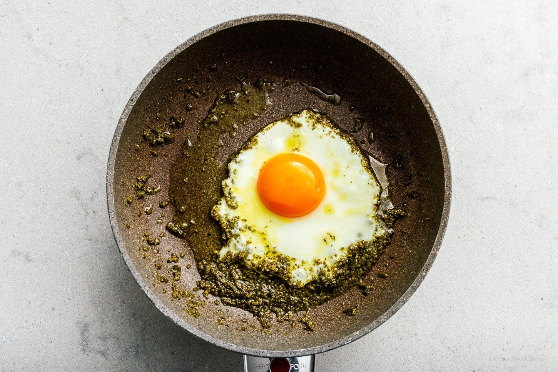 frying egg in pesto | www.iamafoodblog.com